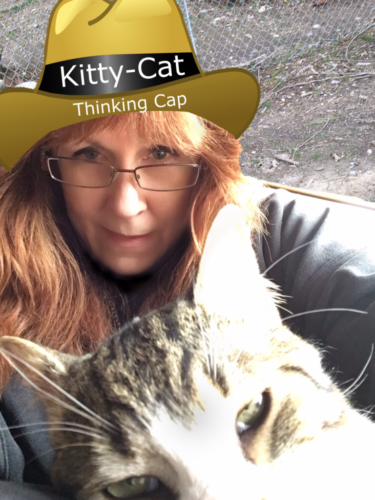 Pet Sitter wearing a Kitty-Cat Thinking Cap